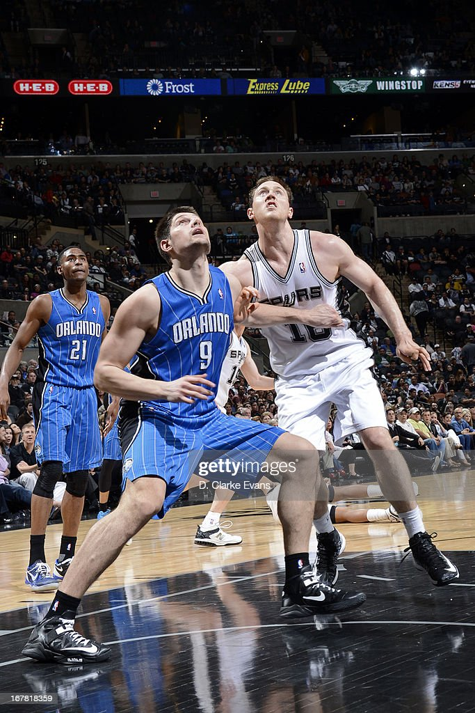Nikola Vucevic #9 of the Orlando Magic battles for positioning against Aron Baynes #16 of the San Antonio Spurs on April 3, 2013 at the AT&T Center in San Antonio, Texas.