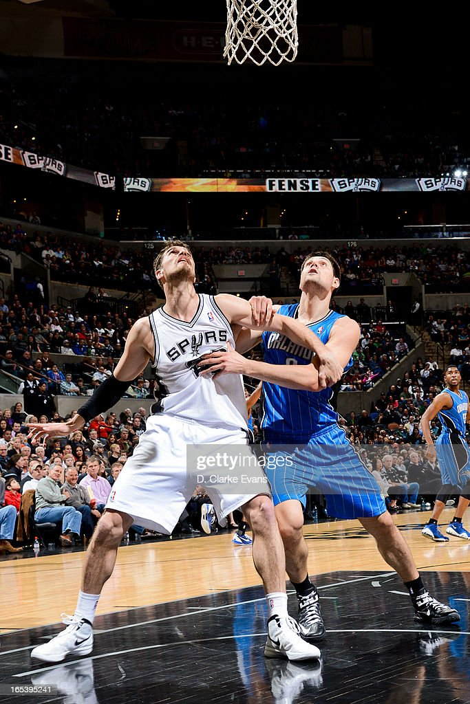 Nikola Vucevic #9 of the Orlando Magic battles for rebound position against Tiago Splitter #22 of the San Antonio Spurs on April 3, 2013 at the AT&T Center in San Antonio, Texas.
