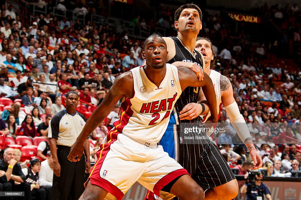 Nikola Vucevic of the Orlando Magic battles for rebound position against Jarvis Varnado and Mike Miller of the Miami Heat on April 17 2013 at...
