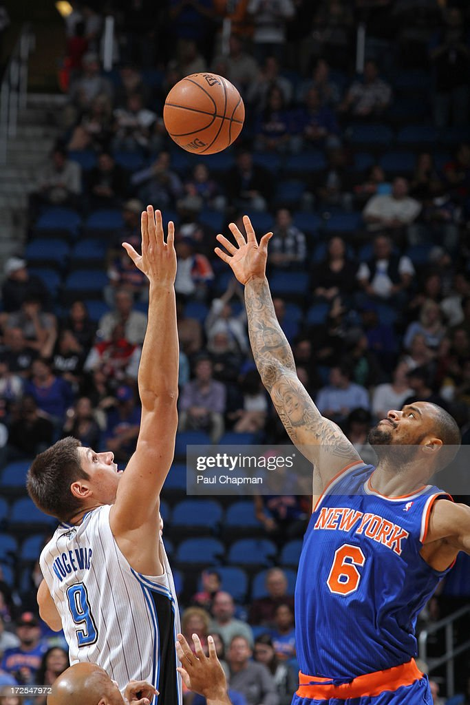 Nikola Vucevic #9 of the Orlando Magic competes with <a gi-track='captionPersonalityLinkClicked' href=/galleries/search?phrase=Tyson+Chandler&family=editorial&specificpeople=202061 ng-click='$event.stopPropagation()'>Tyson Chandler</a> #6 of the New York Knicks for a rebound during the game on January 5, 2013 at Amway Center in Orlando, Florida.