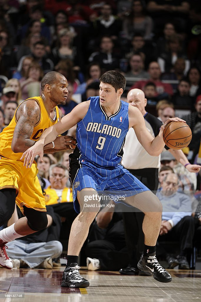 Nikola Vucevic #9 of the Orlando Magic controls the ball against Marreese Speights #15 of the Cleveland Cavaliers at The Quicken Loans Arena on April 7, 2013 in Cleveland, Ohio.