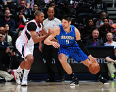 Nikola Vucevic of the Orlando Magic drives against Al Horford of the Atlanta Hawks on February 27 2015 at Philips Arena in Atlanta Georgia NOTE TO...