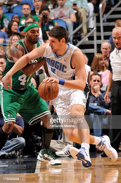 Nikola Vucevic of the Orlando Magic drives against Chris Wilcox of the Boston Celtics on April 13 2013 at Amway Center in Orlando Florida NOTE TO...