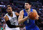 Nikola Vucevic of the Orlando Magic drives against Jared Sullinger of the Boston Celtics during the second quarter at TD Garden on January 29 2016 in...