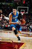Nikola Vucevic of the Orlando Magic drives against the Cleveland Cavaliers at The Quicken Loans Arena on November 24 2014 in Cleveland Ohio NOTE TO...
