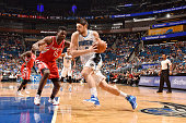 Nikola Vucevic of the Orlando Magic drives to the basket against Clint Capela of the Houston Rockets on December 23 2015 at Amway Center in Orlando...