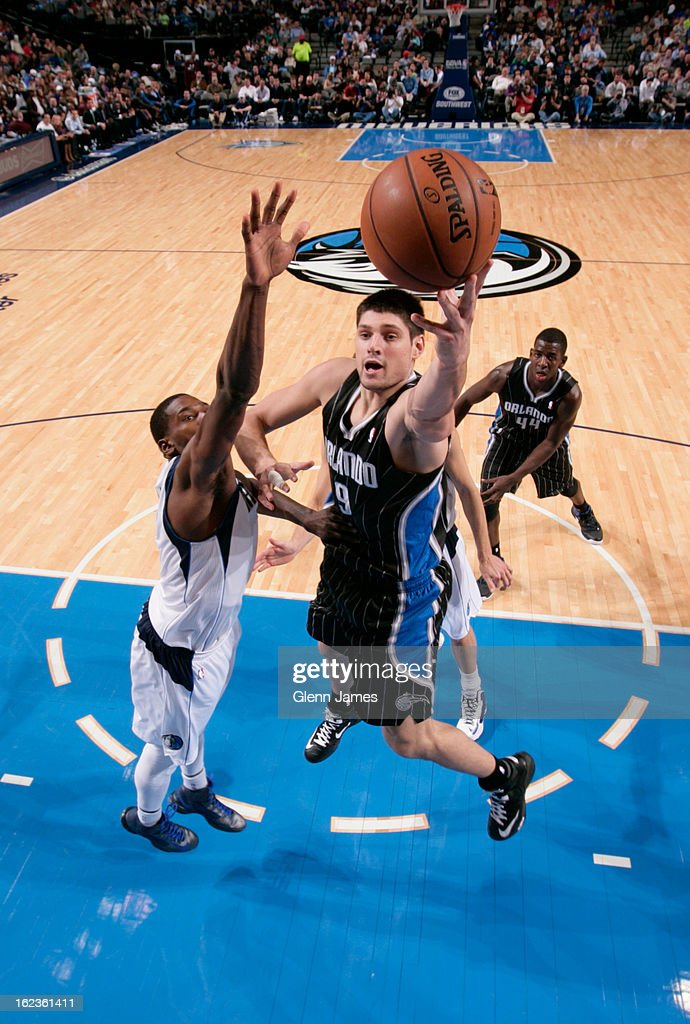 Nikola Vucevic #9 of the Orlando Magic drives to the basket against the Dallas Mavericks on February 20, 2013 at the American Airlines Center in Dallas, Texas.