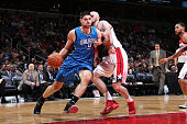 Nikola Vucevic of the Orlando Magic drives to the basket against the Washington Wizards on February 9 2015 at the Verizon Center in Washington DC...