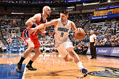 Nikola Vucevic of the Orlando Magic drives to the basket against the Washington Wizards on October 28 2015 at Amway Center in Orlando Florida NOTE TO...