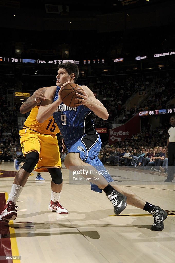 Nikola Vucevic #9 of the Orlando Magic drives to the hoop against Marreese Speights #15 of the Cleveland Cavaliers at The Quicken Loans Arena on April 7, 2013 in Cleveland, Ohio.