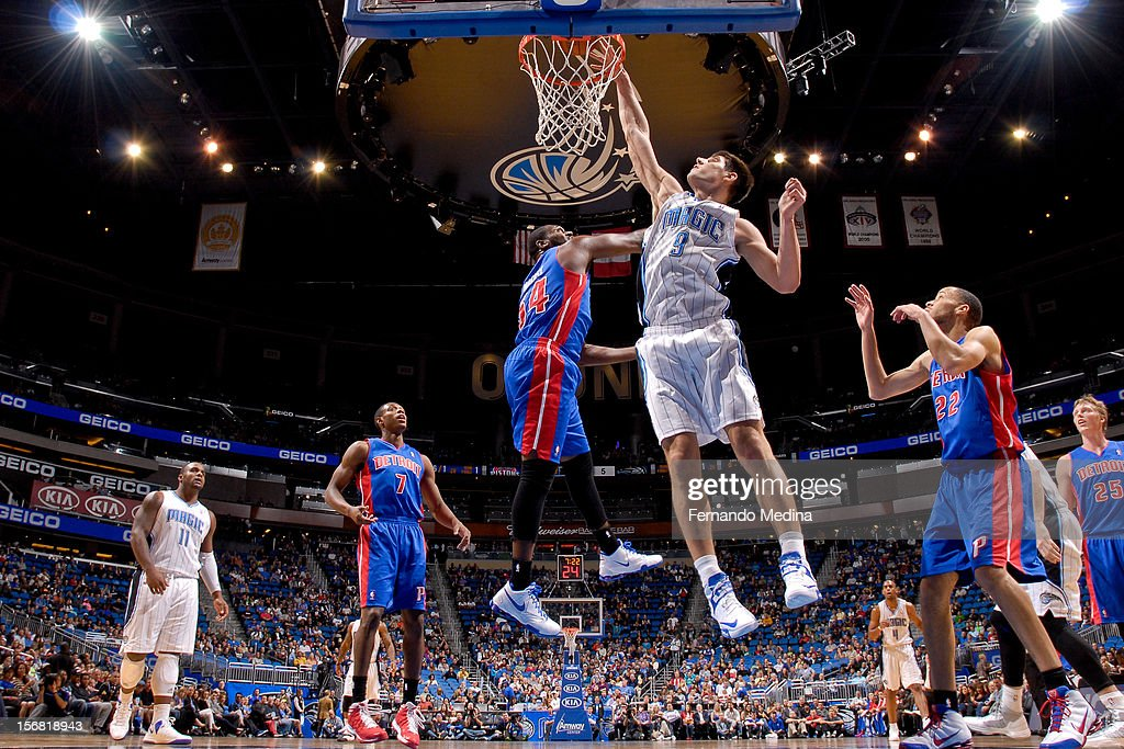 Nikola Vucevic #9 of the Orlando Magic dunks against Jason Maxiell #54 of the Detroit Pistons on November 21, 2012 at Amway Center in Orlando, Florida.
