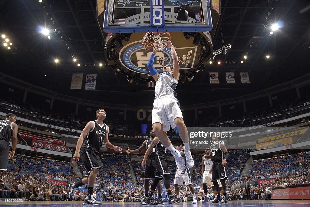 Nikola Vucevic #9 of the Orlando Magic dunks against the Brooklyn Nets on November 3, 2013 at Amway Center in Orlando, Florida.