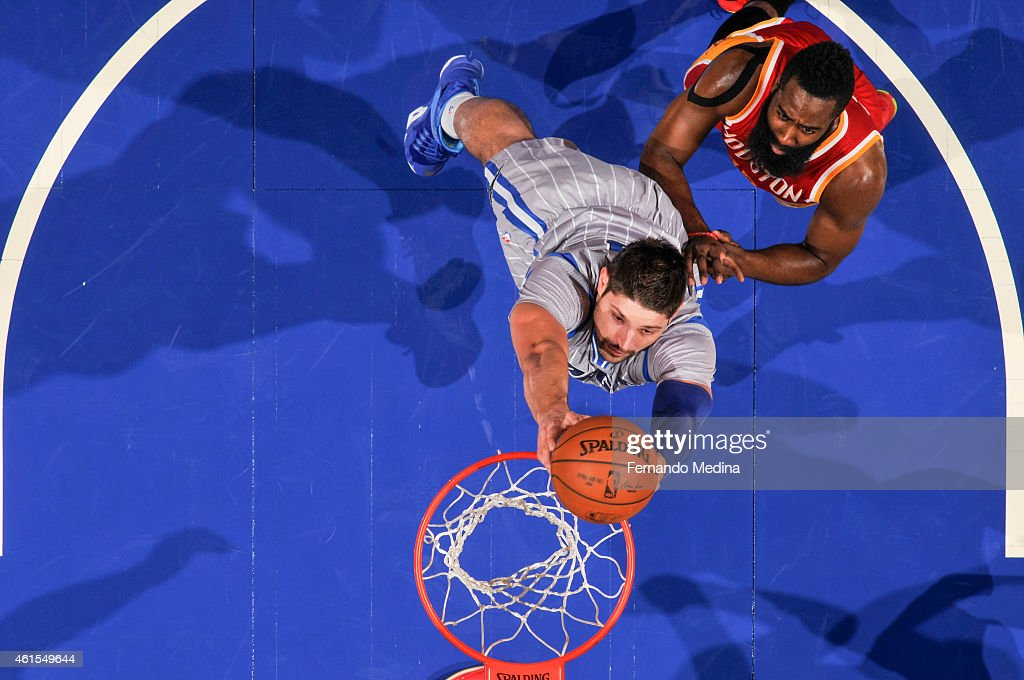 Nikola Vucevic #9 of the Orlando Magic dunks against the Houston Rockets during the game on January 14, 2015 at Amway Center in Orlando, Florida.