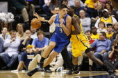Nikola Vucevic of the Orlando Magic goes to the basket against Ian Mahinmi of the Indiana Pacers during the game at Bankers Life Fieldhouse on...