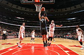 Nikola Vucevic of the Orlando Magic goes to the basket against Joakim Noah of the Chicago Bulls on January 12 2015 at the United Center in Chicago...