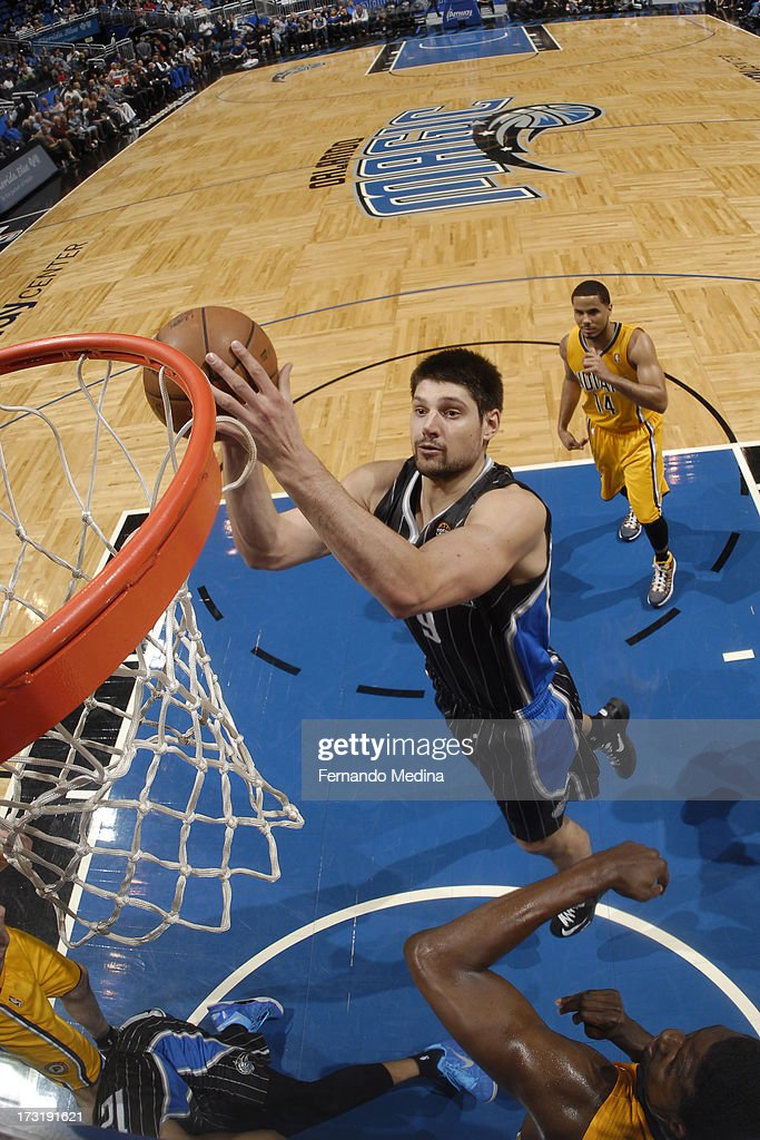 Nikola Vucevic #9 of the Orlando Magic goes to the basket against the Indiana Pacers on March 8, 2013 at Amway Center in Orlando, Florida.