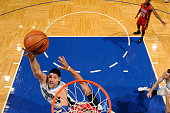 Nikola Vucevic of the Orlando Magic goes to the basket against the New Orleans Pelicans on December 28 2015 at Amway Center in Orlando Florida NOTE...