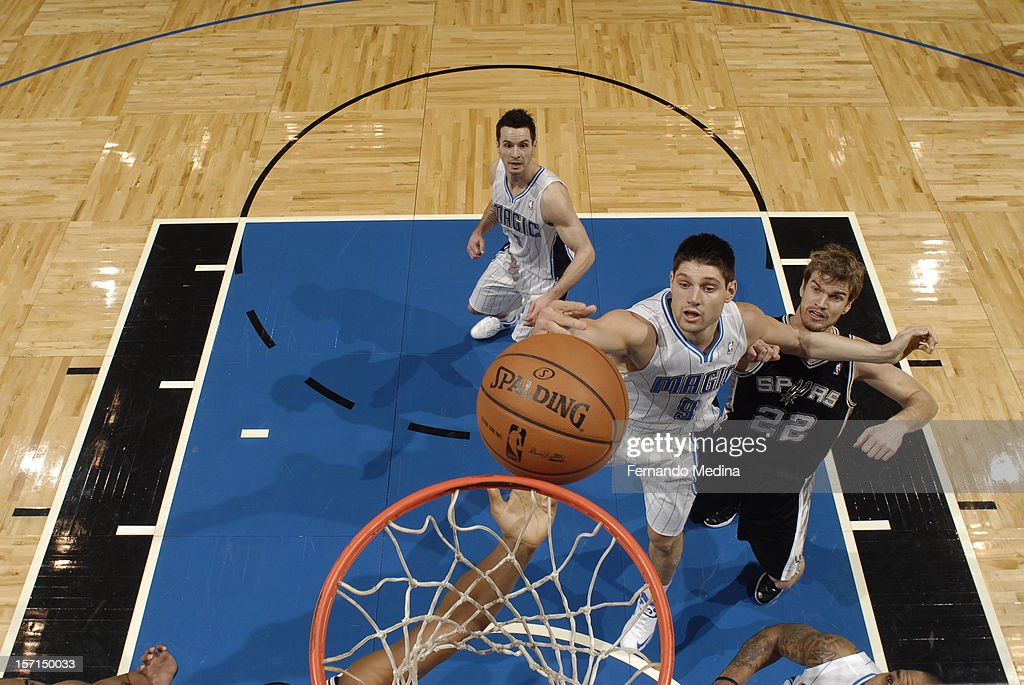 Nikola Vucevic #9 of the Orlando Magic goes to the basket against <a gi-track='captionPersonalityLinkClicked' href=/galleries/search?phrase=Tiago+Splitter&family=editorial&specificpeople=208218 ng-click='$event.stopPropagation()'>Tiago Splitter</a> #22 of the San Antonio Spurs during the game between the San Antonio Spurs and the Orlando Magic on November 28, 2012 at Amway Center in Orlando, Florida.