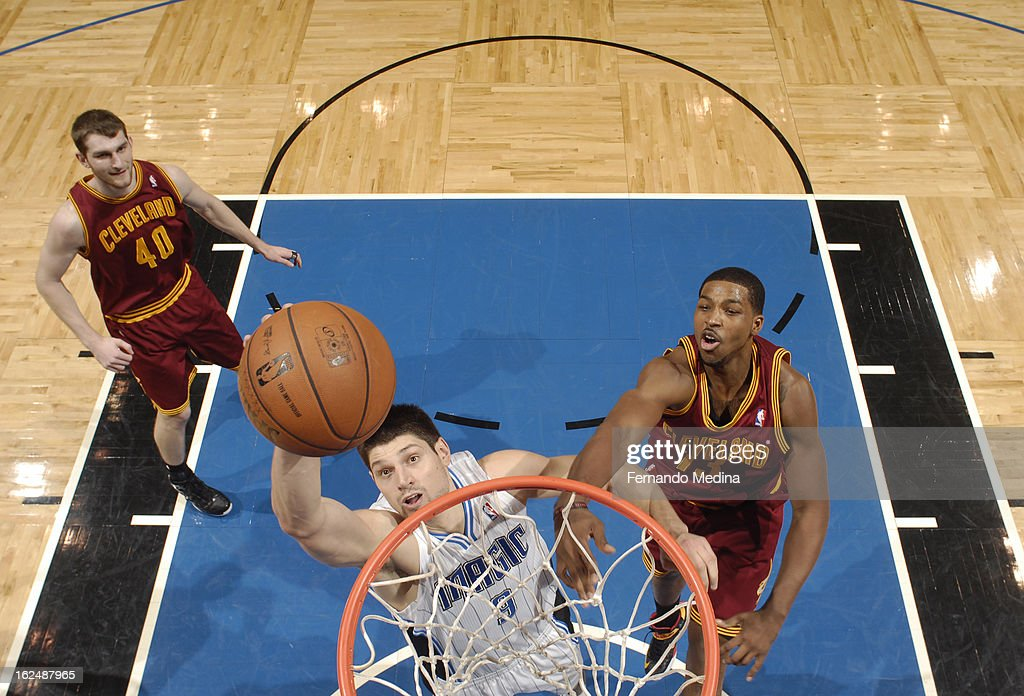 Nikola Vucevic #9 of the Orlando Magic goes to the basket during the game between the Cleveland Cavaliers and the Orlando Magic on February 23, 2013 at Amway Center in Orlando, Florida.