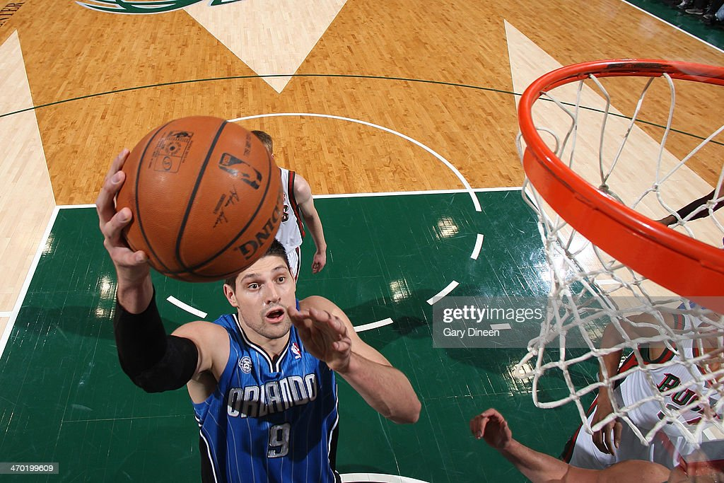 Nikola Vucevic #9 of the Orlando Magic goes up for a layup against the Milwaukee Bucks on February 18, 2014 at the BMO Harris Bradley Center in Milwaukee, Wisconsin.