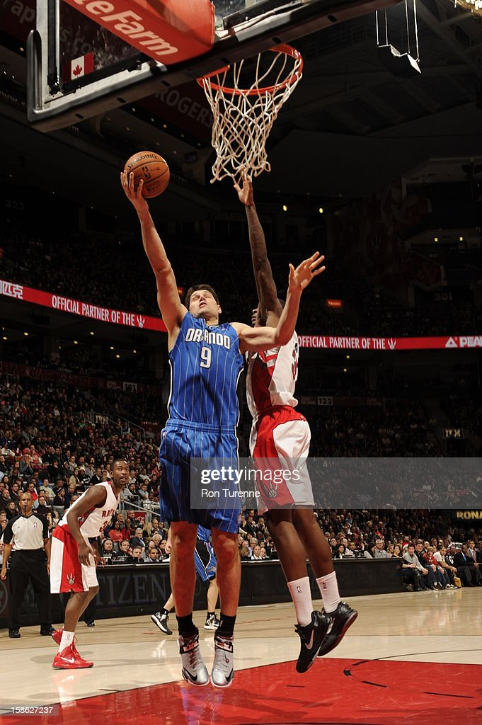 Nikola Vucevic #9 of the Orlando Magic goes up for the short shot against the Toronto Raptors during the game on December 19, 2012 at the Air Canada Centre in Toronto, Ontario, Canada.
