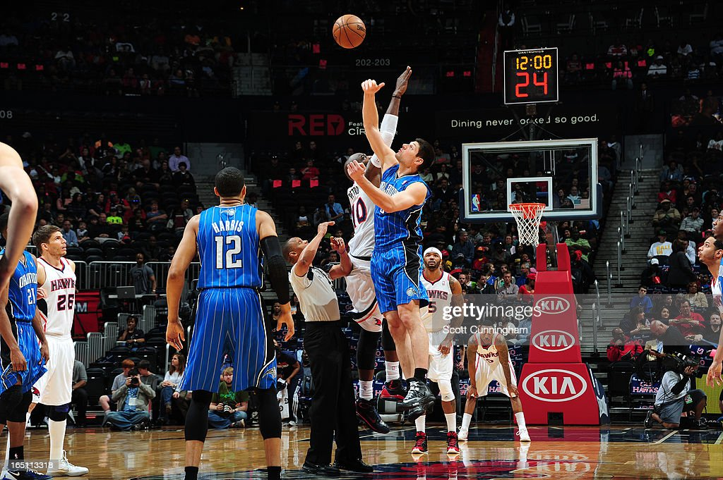 Nikola Vucevic #9 of the Orlando Magic goes up for the tip against of the Atlanta Hawks on March 30, 2013 at Philips Arena in Atlanta, Georgia.