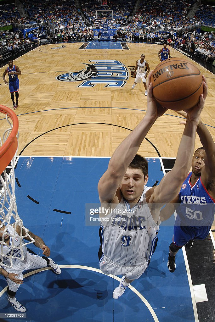 Nikola Vucevic #9 of the Orlando Magic grabs a rebound against <a gi-track='captionPersonalityLinkClicked' href=/galleries/search?phrase=Lavoy+Allen&family=editorial&specificpeople=4628334 ng-click='$event.stopPropagation()'>Lavoy Allen</a> #50 of the Philadelphia 76ers on March 10, 2013 at Amway Center in Orlando, Florida.