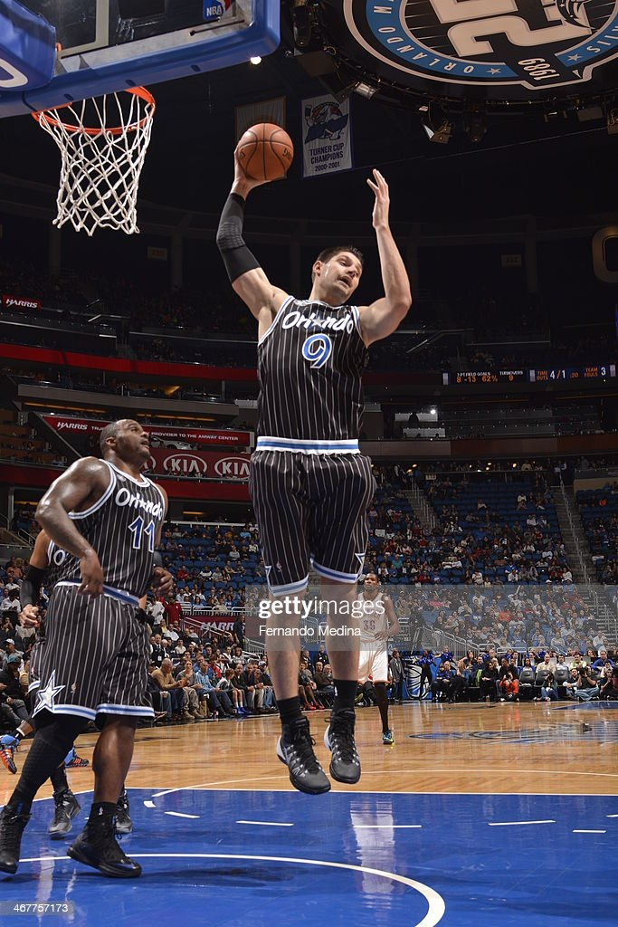 Nikola Vucevic #9 of the Orlando Magic grabs a rebound against the Oklahoma City Thunder during the game on February 7, 2014 at Amway Center in Orlando, Florida.
