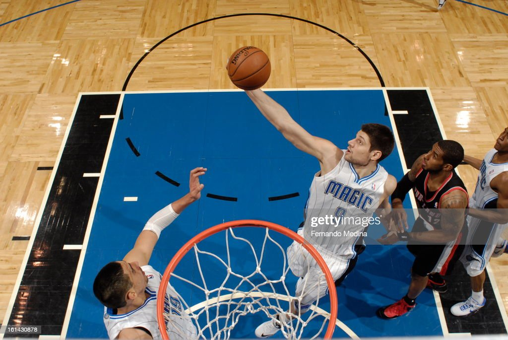 Nikola Vucevic #9 of the Orlando Magic grabs a rebound against the Portland Trail Blazers on February 10, 2013 at Amway Center in Orlando, Florida.