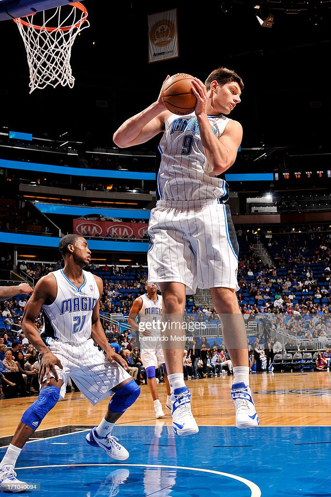 Nikola Vucevic #9 of the Orlando Magic grabs a rebound against the Washington Wizards on December 19, 2012 at Amway Center in Orlando, Florida.