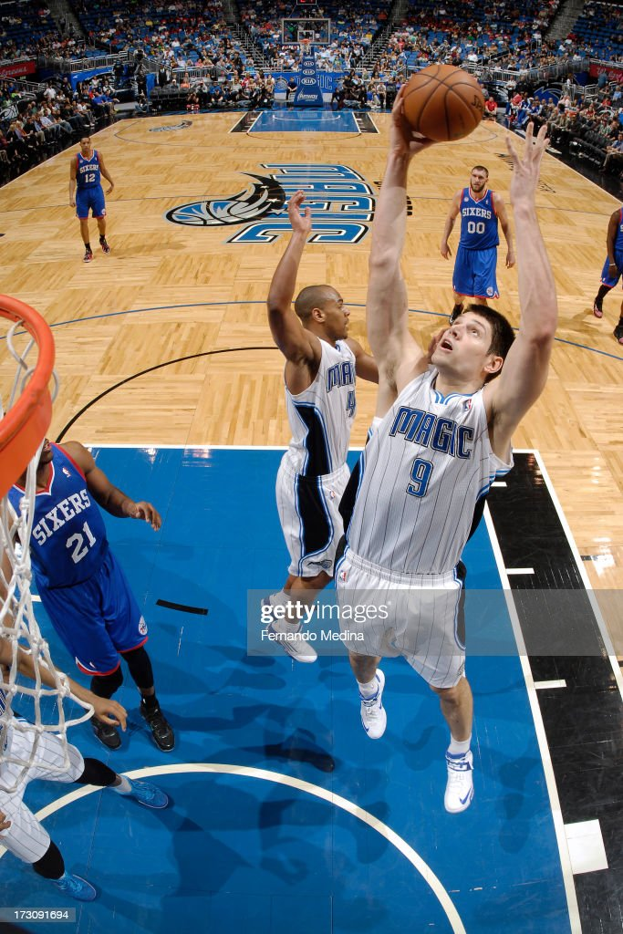 Nikola Vucevic #9 of the Orlando Magic grabs a rebound against the Philadelphia 76ers on March 10, 2013 at Amway Center in Orlando, Florida.