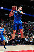 Nikola Vucevic of the Orlando Magic grabs a rebound against the Atlanta Hawks on February 27 2015 at Philips Arena in Atlanta Georgia NOTE TO USER...