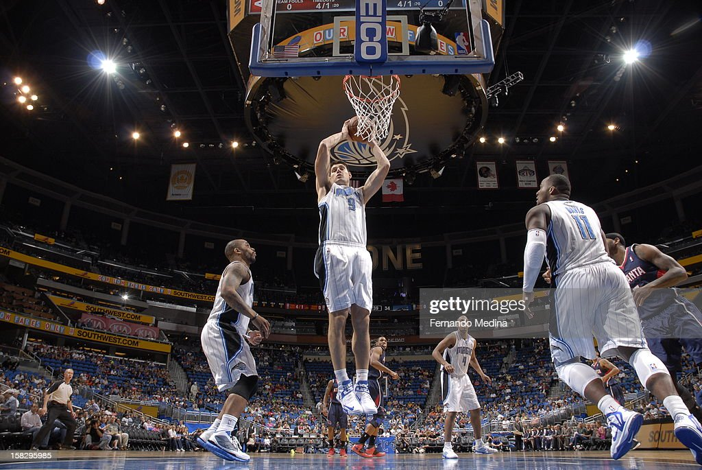 Nikola Vucevic #9 of the Orlando Magic grabs a rebound against the Atlanta Hawks during the game on December 12, 2012 at Amway Center in Orlando, Florida.
