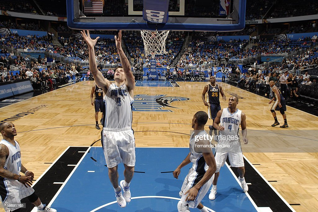 Nikola Vucevic #9 of the Orlando Magic grabs a rebound against the Utah Jazz during the game on December 23, 2012 at Amway Center in Orlando, Florida.