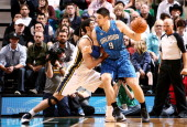 Nikola Vucevic of the Orlando Magic handles the ball against Enes Kanter of the Utah Jazz at EnergySolutions Arena on March 22 2014 in Salt Lake City...