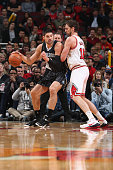 Nikola Vucevic of the Orlando Magic handles the ball against Pau Gasol of the Chicago Bulls on January 12 2015 at the United Center in Chicago...