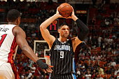 Nikola Vucevic of the Orlando Magic handles the ball against the Miami Heat on April 13 2015 at American Airlines Arena in Miami Florida NOTE TO USER...