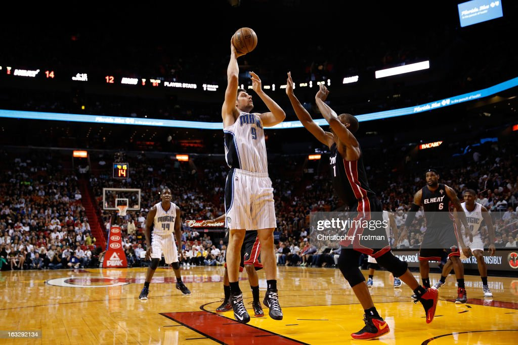 Nikola Vucevic #9 of the Orlando Magic is challenged by Chris Bosh #1 of the Miami Heat at American Airlines Arena on March 6, 2013 in Miami, Florida.
