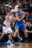 Nikola Vucevic of the Orlando Magic looks to drive to the basket against David Lee of the Dallas Mavericks on March 1 2016 at the American Airlines...