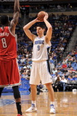 Nikola Vucevic of the Orlando Magic looks to pass the ball against Larry Sanders of the Milwaukee Bucks during the game on April 10 2013 at Amway...