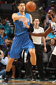 Nikola Vucevic of the Orlando Magic passes the ball against the Charlotte Hornets during the game at the Time Warner Cable Arena on December 27 2014...
