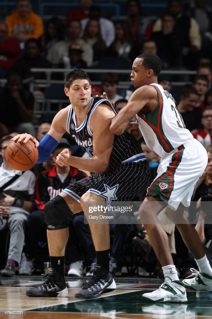 Nikola Vucevic #9 of the Orlando Magic posts up against the Milwaukee Bucks on March 10, 2014 at the BMO Harris Bradley Center in Milwaukee, Wisconsin.