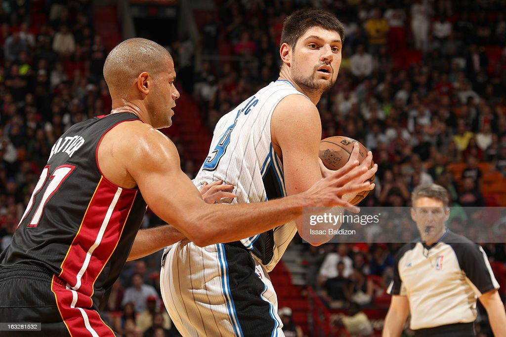 Nikola Vucevic #9 of the Orlando Magic protects the ball from <a gi-track='captionPersonalityLinkClicked' href=/galleries/search?phrase=Shane+Battier&family=editorial&specificpeople=201814 ng-click='$event.stopPropagation()'>Shane Battier</a> #31 of the Miami Heat during the game between the Orlando Magic and the Miami Heat on March 6, 2013 at American Airlines Arena in Miami, Florida.