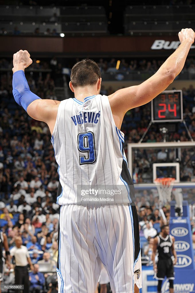 Nikola Vucevic #9 of the Orlando Magic reacts after a play against the Brooklyn Nets during the game on December 30, 2015 at Amway Center in Orlando, Florida.