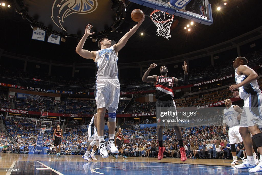 Nikola Vucevic #9 of the Orlando Magic rebounds against the Portland Trail Blazers on February 10, 2013 at Amway Center in Orlando, Florida.