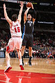 Nikola Vucevic of the Orlando Magic shoots against Pau Gasol of the Chicago Bulls on January 12 2015 at the United Center in Chicago Illinois NOTE TO...