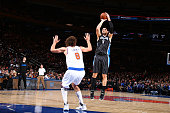 Nikola Vucevic of the Orlando Magic shoots against Robin Lopez of the New York Knicks on December 21 2015 at Madison Square Garden in New York City...