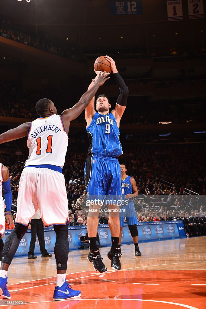 Nikola Vucevic of the Orlando Magic shoots against Samuel Dalembert of the New York Knicks during the game on November 12 2014 at Madison Square...