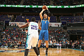 Nikola Vucevic of the Orlando Magic shoots against the Charlotte Hornets during the game at the Time Warner Cable Arena on December 27 2014 in...