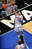 Nikola Vucevic of the Orlando Magic shoots against the Denver Nuggets on March 22 2015 at Amway Center in Orlando Florida NOTE TO USER User expressly...